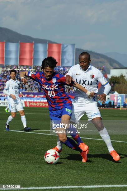 Shohei Ogura of Ventforet Kofu controls the ball under pressure of Leo Silva of Kashima Antlers during the JLeague J1 match between Ventforet Kofu...