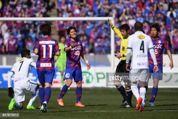 Shohei Ogura of Ventforet Kofu protests to referee Yoshiro Imamura after Hideomi Yamamoto of Ventforet Kofu is shown a yellow card during the JLeague...