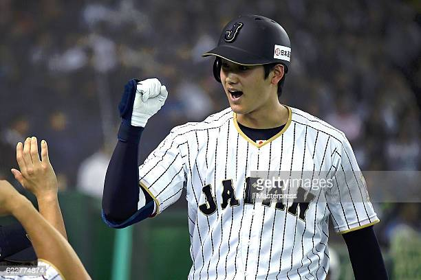 Shohei Ohtani of Japan celebrates after hitting a solo homer in the fifth inning during the international friendly match between Japan and...