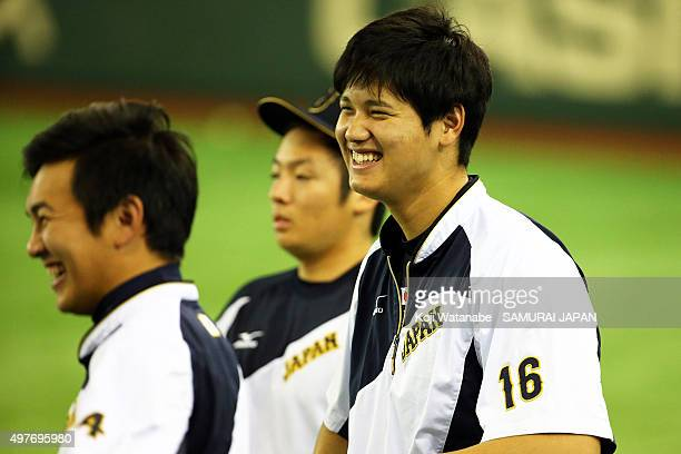 Shohei Ohtani of Japan looks on a training session ahead of the WBSC Premier 12 semi final match against South Korea at the Tokyo Dome on November 18...