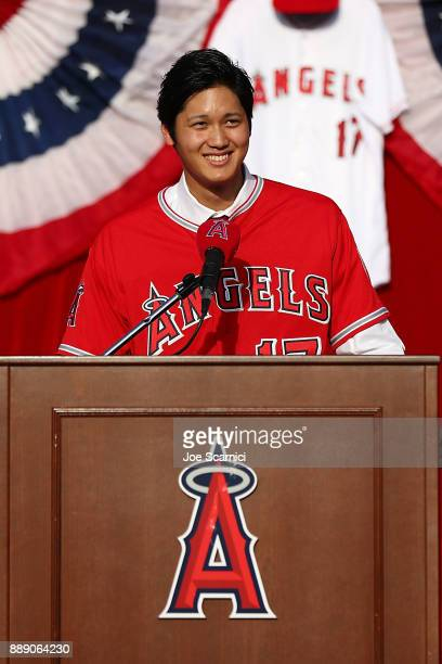 Shohei Ohtani speaks onstage as he is introduced to the Los Angeles Angels of Anaheim at Angel Stadium of Anaheim on December 9 2017 in Anaheim...