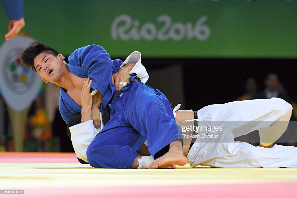Shohei Ono of Japan and Lasha Shavdatuashvili of Georgia compete in the Men's 73kg quarterfinal on Day 3 of the Rio 2016 Olympic Games at Carioca...