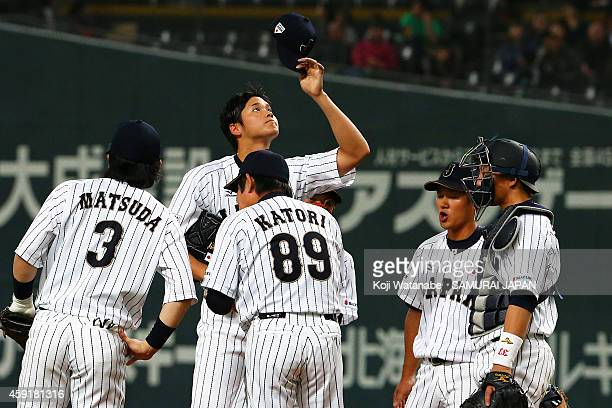 Shohei Otani and Samurai Japan gather at the mound with pitching coach during the game five of Samurai Japan and MLB All Stars at Sapporo Dome on...