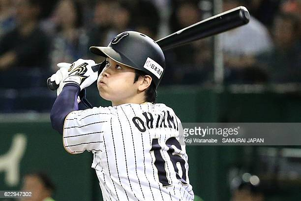 Shohei Otani hits a double in the eighth inning during the international friendly match between Japan and Netherlands at the Tokyo Dome on November...