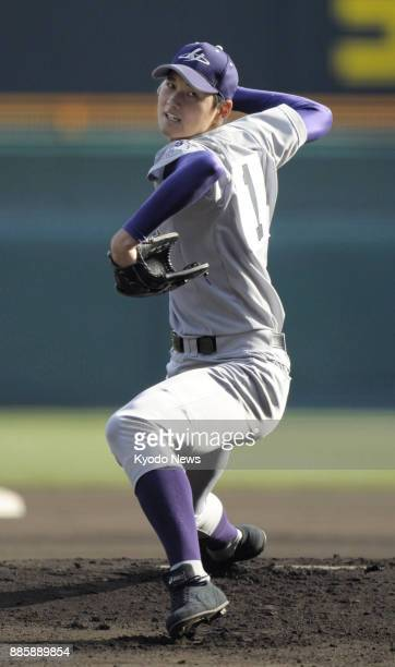 Shohei Otani of Hanamaki Higashi High School pitches in national high school tournament game at Koshien Stadium Hyogo Prefecture on March 21 2012...
