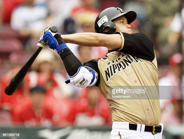 Shohei Otani of the Nippon Ham Fighters hits an RBI double in a game against the Hiroshima Carp at Hiroshima's Mazda Stadium on June 21 2014 ==Kyodo
