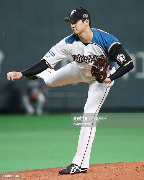 Shohei Otani of the Nippon Ham Fighters pitches against the SoftBank Hawks in Game 1 of the Pacific League Climax Series final stage at Sapporo Dome...