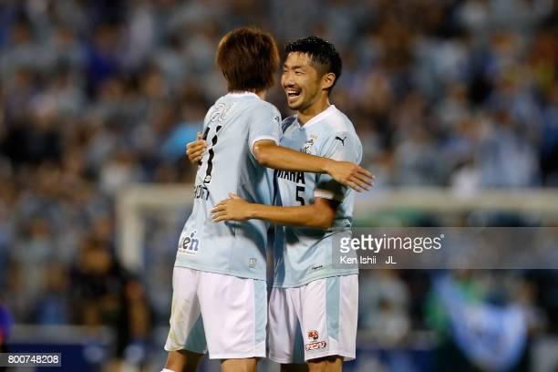 Shohei Takahashi and Nagisa Sakurauchi of Jubilo Iwata celebrate their 20 victory during the JLeague J1 match between Jubilo Iwata and FC Tokyo at...
