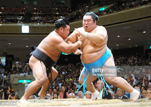 Shohozan pushes Tokushoryu out of the ring to win during final day of the Grand Sumo Autumn Tournament at Ryogoku Kokugikan on September 25 2016 in...
