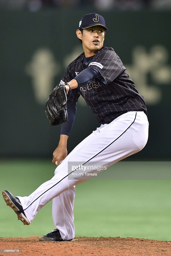 Shoichi Inou #15 of Samurai Japan pitches in the seventh inning during the game two of Samurai Japan and MLB All Stars at Tokyo Dome on November 14, 2014 in Tokyo, Japan.
