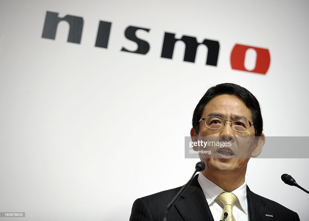 Shoichi Miyatani, president of Nissan Motorsports International Co., speaks at the opening of the Nismo global headquarters and development center in Yokohama City, Japan, on Tuesday, Feb. 26, 2013. Chief Executive Officer Carlos Ghosn, who has called 100 yen to the dollar the 'neutral' value for the Japanese currency, said the yen should weaken further. Photographer: Akio Kon/Bloomberg via Getty Images