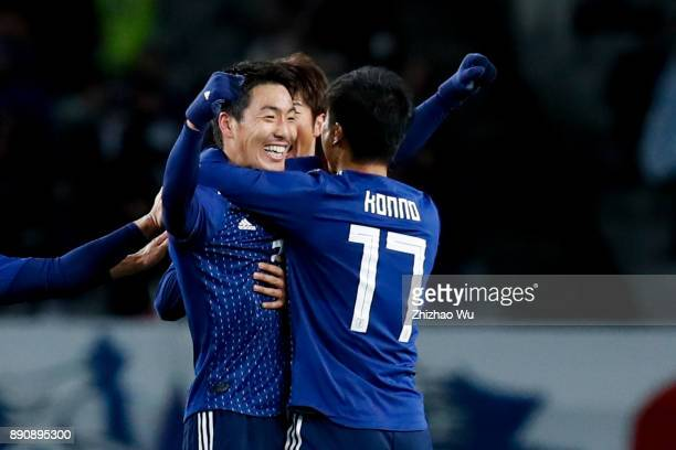 Shoji Gen of Japan celebrates with his teamates for his scoring during the EAFF E1 Men's Football Championship match between Japan and China at...