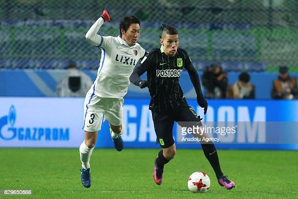 Shoji Gen of Kashima Antlers and Mateus Uribe of Atletico Nacional in action during the semi final match between Atletico Nacional and Kashima...
