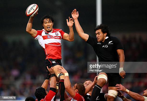 Shoji Ito of Japan clears the ball in the lineout under pressure from Steven Luatua of the All Blacks during the International Rugby Test Match...