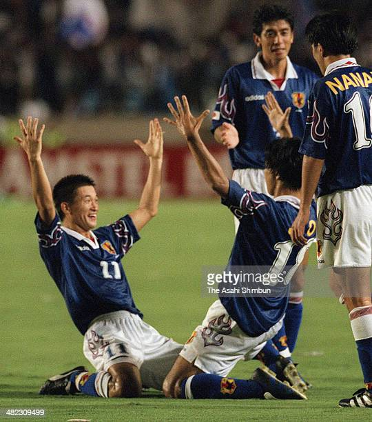 Shoji Jo of Japan celebrates scoring his team's fourth goal with his teammate Kazuyoshi Miura during the France World Cup Asian Qualifier Final Round...