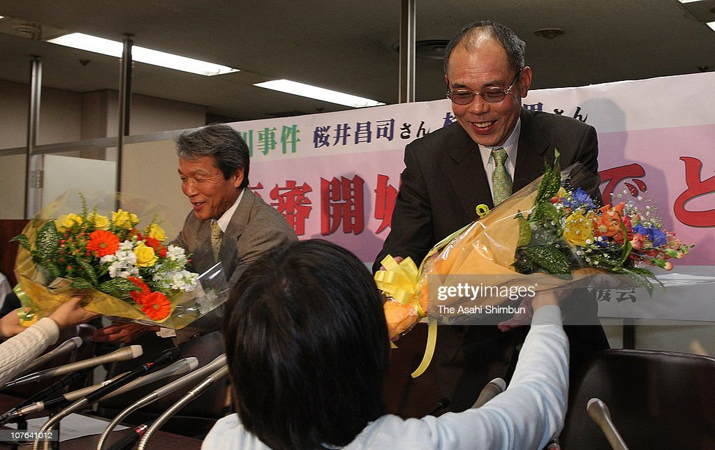 Shoji Sakurai (L) and Takao Sugiyama receive flower bunches from their supporter after the Supreme Court deciding to retry Fukawa Incident during a press conference at Justice Ministry on December 15, 2009 in Tokyo, Japan. Sakurai and Sugiyama were sentenced to life in prison but have appealed they were innocent of the robbery-murder in 1967 in Ibaraki.