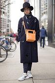 Shoka Xu is seen on Michigan Avenue wearing a black HM hat dark blue patterned wool COS coat blue patterned Topshop scarf tan leather MM6 bag dark...