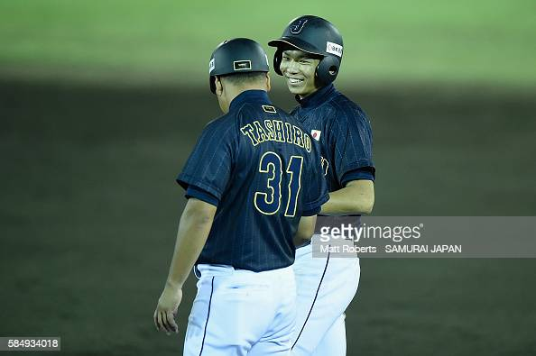 Shoki Koyama of Japan smiles on first base with Eiji Tashiro in the top half of the fifth inning in the game between Czech Republic and Japan during...