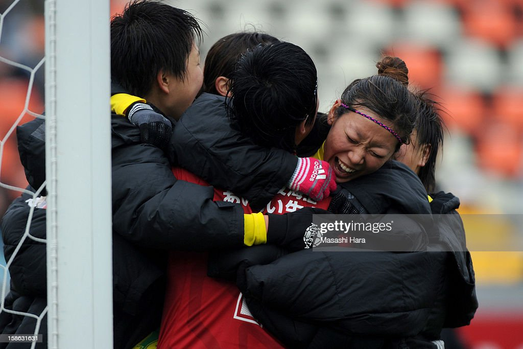 Shoko Chino #24 of JEF United Chiba Ladies celebrates the win with Mayu Funada during the 34th Empress's Cup All Japan Women's Football Tournament semi final match between Iga FC Kunoichi and JEF United Chiba Ladies at Nack 5 Stadium Omiya on December 22, 2012 in Saitama, Japan.