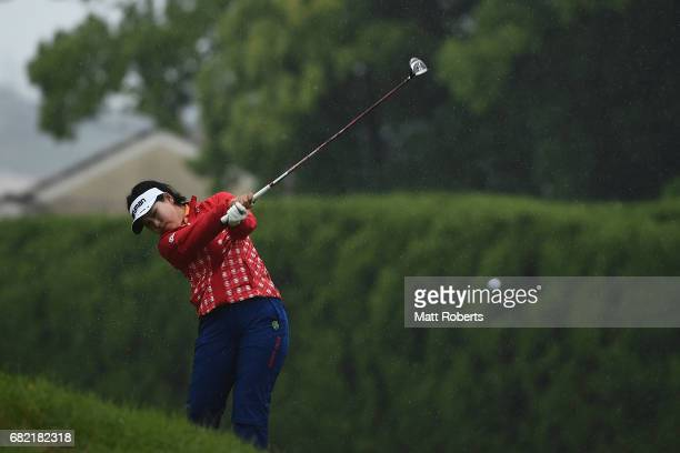Shoko Sasaki of Japan hits her second shot on the 11th hole during the first round of the HokennoMadoguchi Ladies at the Fukuoka Country Club Wajiro...
