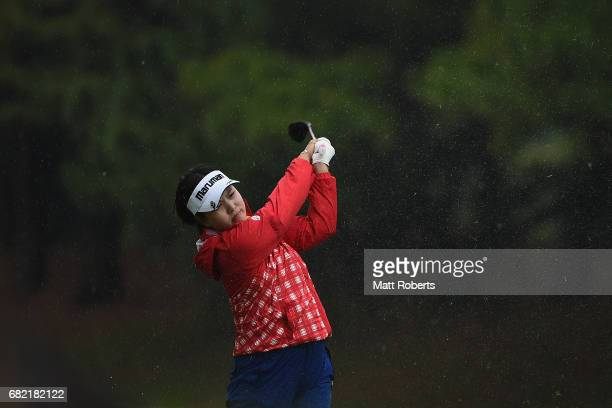 Shoko Sasaki of Japan plays her approach shot on the 11th hole during the first round of the HokennoMadoguchi Ladies at the Fukuoka Country Club...