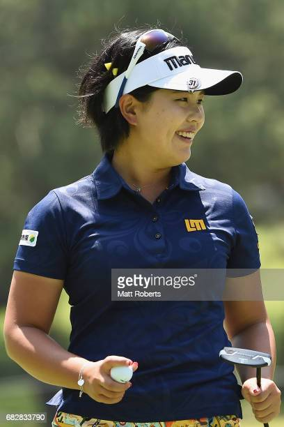 Shoko Sasaki of Japan reacts after her putt on the 8th green during the final round of the HokennoMadoguchi Ladies at the Fukuoka Country Club Wajiro...