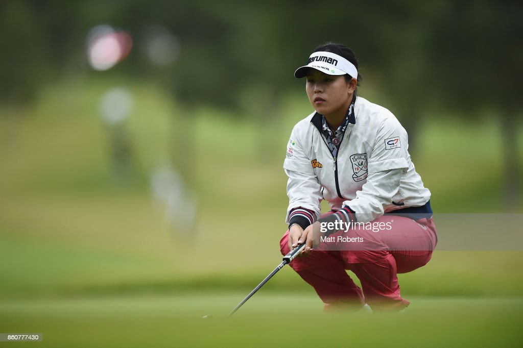 Shoko Sasaki of Japan waits to putt on the first green during the first round of the Fujitsu Ladies 2017 at the Tokyu Seven Hundred Club on October 13, 2017 in Chiba, Japan.