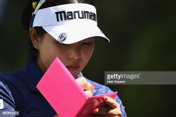 Shoko Sasaki of Japan writes in her scorecard during the final round of the HokennoMadoguchi Ladies at the Fukuoka Country Club Wajiro Course on May...