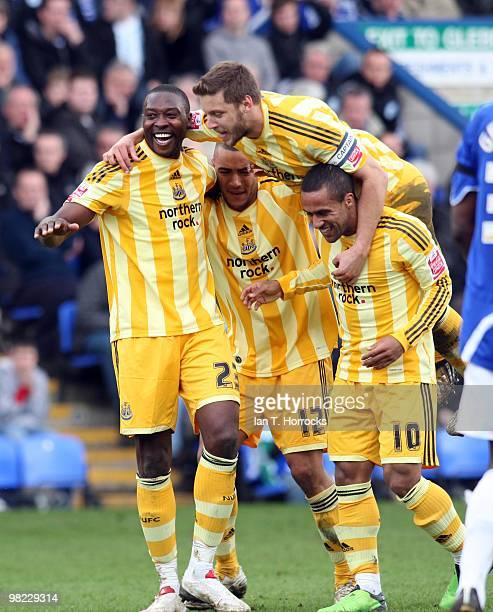 Shola Ameobi celebrates with his team mates after scoring Newcastle's third goal during the Coca Cola Championship match between Peterborough United...