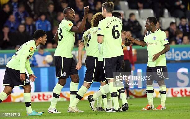 Shola Ameobi celebrates with teammates after scoring his team's second goal during the UEFA Europa League group D match between Club Brugge KV and...