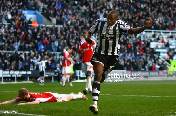 Shola Ameobi of Newcastle celebrates after scoring the second Newcastle goal during the CocaCola Championship match between Newcastle United and...