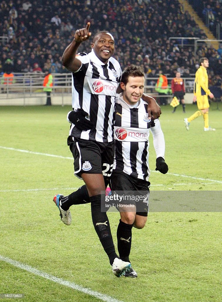 <a gi-track='captionPersonalityLinkClicked' href=/galleries/search?phrase=Shola+Ameobi&family=editorial&specificpeople=211410 ng-click='$event.stopPropagation()'>Shola Ameobi</a> of Newcastle United (left) celebrates with Yohan Cabaye after scoring from the penalty spot during the UEFA Europa League round of 32 second leg match between FC Metalist Kharkiv and Newcastle United FC at Metalist Stadium, on February 21, 2013 in Kharkov, Ukraine.