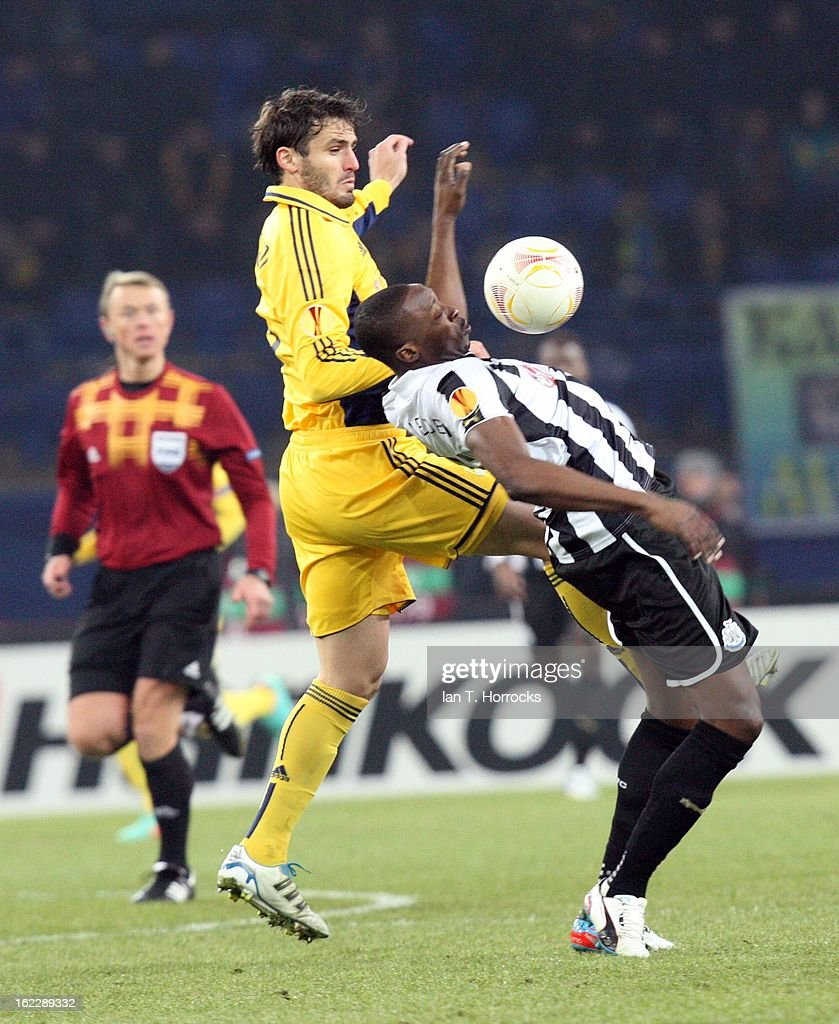 Shola Ameobi of Newcastle United (R) challenges Edmar of Metalist Kharkiv during the UEFA Europa League round of 32 second leg match between FC Metalist Kharkiv and Newcastle United FC at Metalist Stadium, on February 21, 2013 in Kharkov, Ukraine.