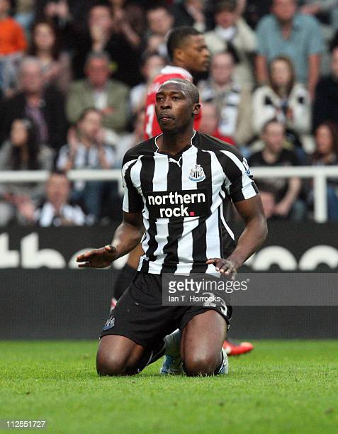 Shola Ameobi of Newcastle United reacts during the Barclays Premier League match between Newcastle United and Manchester United at St James' Park on...