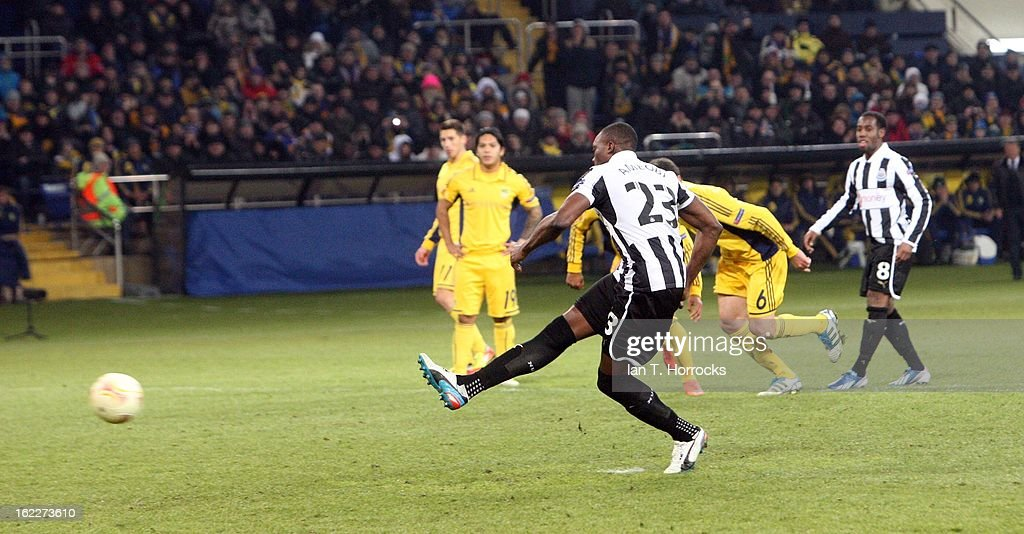 <a gi-track='captionPersonalityLinkClicked' href=/galleries/search?phrase=Shola+Ameobi&family=editorial&specificpeople=211410 ng-click='$event.stopPropagation()'>Shola Ameobi</a> of Newcastle United scores from the penalty spot during the UEFA Europa League round of 32 second leg match between FC Metalist Kharkiv and Newcastle United FC at Metalist Stadium, on February 21, 2013 in Kharkov, Ukraine.