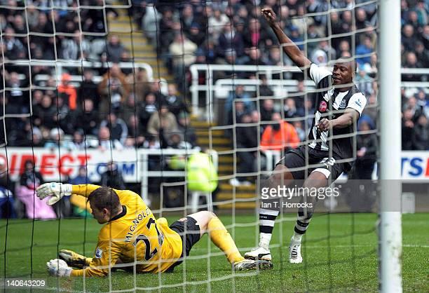 Shola Ameobi of Newcastle United scores the equalising goal past sunderland goalkeeper Simon Mignolet during the Barclays Premier League match...