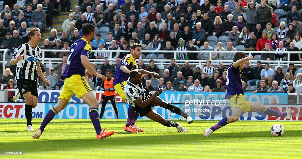 <a gi-track='captionPersonalityLinkClicked' href=/galleries/search?phrase=Shola+Ameobi&family=editorial&specificpeople=211410 ng-click='$event.stopPropagation()'>Shola Ameobi</a> of Newcastle United (R2) scores the opening goal during the Barclays Premier League match between Newcastle United and Swansea City at St James' Park on April 19, 2014 in Newcastle upon Tyne, England.