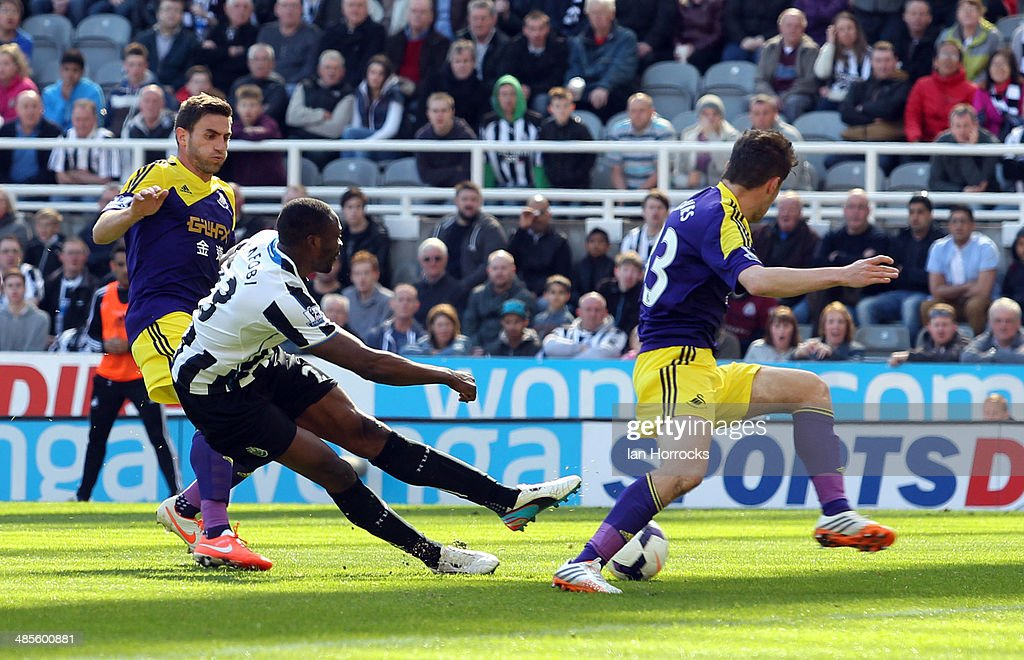 <a gi-track='captionPersonalityLinkClicked' href=/galleries/search?phrase=Shola+Ameobi&family=editorial&specificpeople=211410 ng-click='$event.stopPropagation()'>Shola Ameobi</a> of Newcastle United (L) scores the opening goal during the Barclays Premier League match between Newcastle United and Swansea City at St James' Park on April 19, 2014 in Newcastle upon Tyne, England.