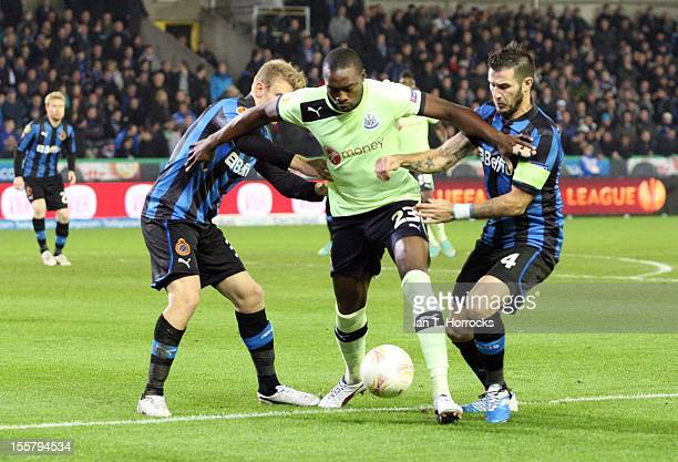 Shola Ameobi of Newcastle United takes on Michael Alemback and Carl Hoefkens during the UEFA Europa League group D match between Club Brugge KV and...