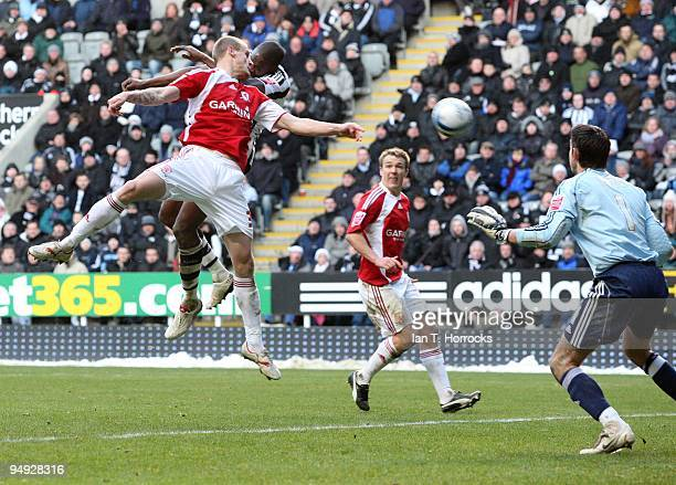 Shola Ameobi scores the second goal during the CocaCola championship match between Newcastle United and Miiddlesbrough at St James' Park on December...
