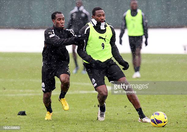 Shola Ameobi under pressure from Vurnon Anita during a Newcastle United training session at the Little Benton training ground on January 25 2013 in...