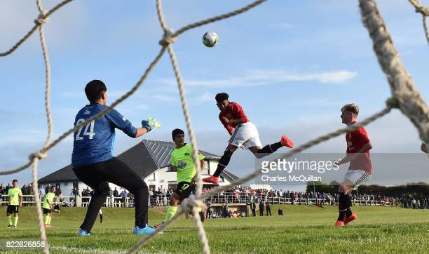 Shola Shoretire of Manchester United heads an effort over the crossbar during the NI Super Cup junior section game between Manchester United and...