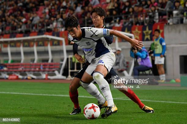 Shoma Doi of Kashima Antlers and Genta Miura of Gamba Osaka compete for the ball during the JLeague J1 match between Kashima Antlers and Gamba Osaka...