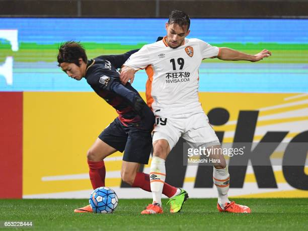 Shoma Doi of Kashima Antlers and Jack Hingert of Brisbane Roar compete for the ball during the AFC Champions League Group E match between Kashima...