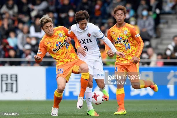 Shoma Doi of Kashima Antlers and Ko Matsubara of Shimizu SPulse compete for the ball during the JLeague J1 match between Shimizu SPulse and Kashima...