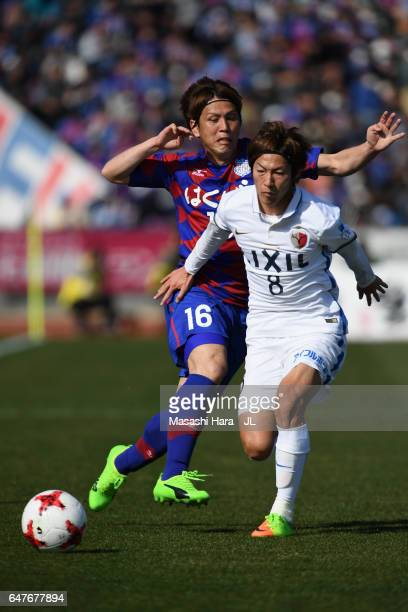 Shoma Doi of Kashima Antlers and Masaru Matsuhashi of Ventforet Kofu compete for the ball during the JLeague J1 match between Ventforet Kofu and...