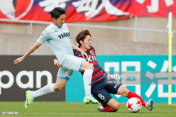 Shoma Doi of Kashima Antlers and Nagisa Sakurauchi of Jubilo Iwata compete for the ball during the JLeague J1 match between Kashima Antlers and...