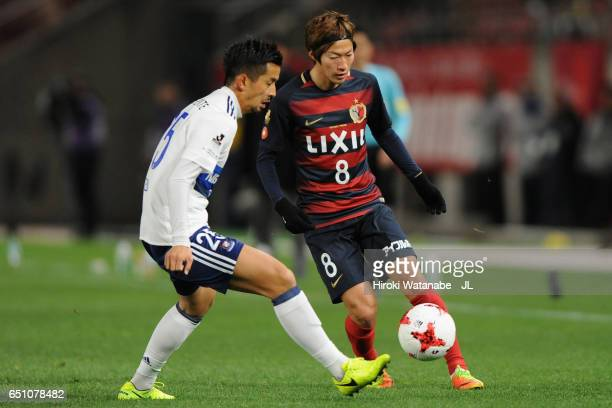 Shoma Doi of Kashima Antlers and Naoki Maeda of Yokohama FMarinos compete for the ball during the JLeague J1 match between Kashima Antlers and...