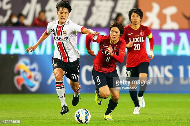 Shoma Doi of Kashima Antlers and Park Yongwoo of FC Seoul compete for the ball during the AFC Champions League Group H match between Kashima Antlers...
