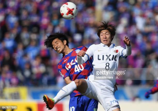 Shoma Doi of Kashima Antlers and Shohei Ogura of Ventforet Kofu compete for the ball during the JLeague J1 match between Ventforet Kofu and Kashima...